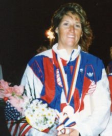 Lynne Shore with Olympic Medal